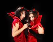 Two Devils Clinking Glasses of Red Wine — Stock Photo