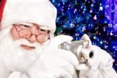 Santa Claus Shoots a Digital Camera Christmas Tree in the Backgr — Stock Photo