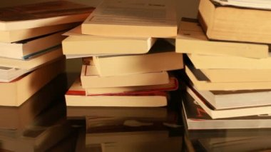 Stacked books on table — Stock Video