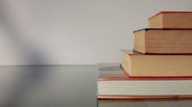 Hand walking on books — Stock Video