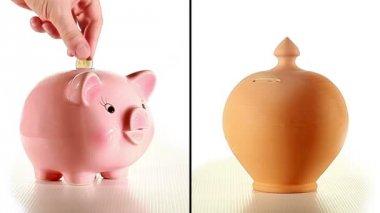 Hand puts money into moneyboxes — Stock Video