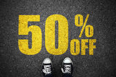 Discount percent sign on asphalt — Stock Photo