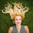 Young blonde woman summer day relaxing — Stock Photo #75481939