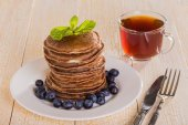 Homemade chocolate pancakes with berries  — Stock Photo