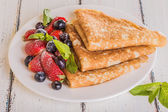 Homemade crepes with berries and fruit  — Stockfoto