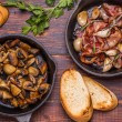 Fried mushrooms with bacon, garlic, rosemary — Stock Photo #67480209