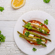 Bruschetta with goat cheese and grilled asparagus — Stock Photo #70089143