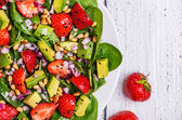Salad with strawberries, avocados, spinach — Stock Photo