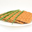 Dietary bread with green onion on white plate — Stock Photo #72806355