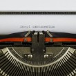 Exegi monumentum word printed on an old typewriter — Stock Photo #67264141
