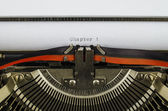 Chapter 1 word printed on an old typewriter — Stock Photo