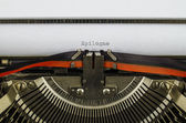 Epilogue word printed on an old typewriter — Stock Photo