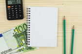 Office, business tools with notebook and euro on wooden table — Stock Photo