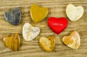 Many different hearts on wooden table — Stock Photo