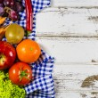 Frame of fresh fruits and vegetables on wooden table — Stock Photo #74154305