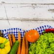 Frame of fresh fruits and vegetables on wooden table — Stock Photo #74154529