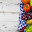 Frame of fresh fruits and vegetables on wooden table — Stock Photo #74154677