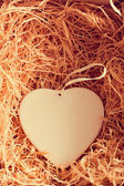 Heart in a box with straw — Stock Photo