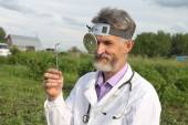 Doctor otolaryngologist in rural areas before work — Stock Photo