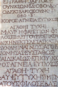 Stone background with antique Greek inscriptions — Stock Photo