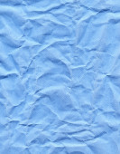 Wrinkled blue paper fragment as a background texture — Stock Photo