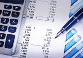 Report with blue pen and calculator for the business concept — Stock Photo