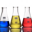 Laboratory glassware with blue,yellow and red liquid — Stock Photo #69744977
