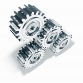 Three Nickel Metal Gears Meshing Together on a White Background — Stock Photo