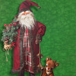 Santa Clause and Rudolf the Red-nosed reindeer — Stock Photo #64113011