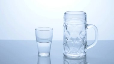 Glass of water on table — Stock Video