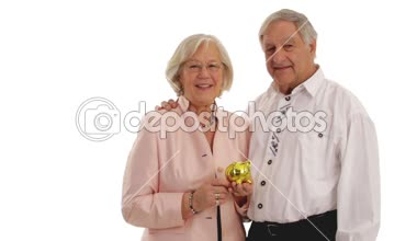 Couple of senior citizen with piggybank. — Stock Video