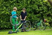 Two boys repairing a bicycle — Stock Photo