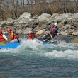Manali, India - December 28, 2013: Tourists enjoy white water rafting in the Beas river in the Himalayas, Manali, India — Stock Photo #70363687