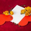 Two red hearts in the envelope with dried roses and coffee beans — Stock Photo #63574463