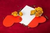 Two red hearts in the envelope with dried roses and coffee beans — Stock Photo