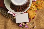 The cup of coffee lying on the books with maple leaves — Stock Photo