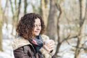 Woman drinking coffee in winter — Stock Photo
