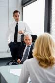 Three businesspeople having a meeting in the office — Stock Photo
