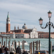 Tourists waiting gondola on San Marco embankment. — Stock Photo #67194173