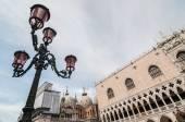 Beautiful venetian ornate lampposts with pink murano glass. Venice, Italy. — Stock Photo
