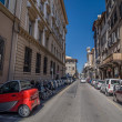 Small red electric car on street Borgo Ognissanti in Florence. — Stock Photo #67770055