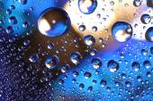 Water drops on plastic surface — Stock Photo