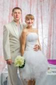 Bride and groom in wedding studio — Stock Photo