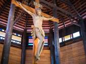 Jesus on cross in the wooden church — Stockfoto
