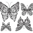Vector set of black and white ornamental  butterflies isolated o — Stock Vector #74400775