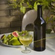 Still life - wine,grapes and figs outdoors. — Stock Photo #68186579