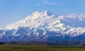 Wonderful Elbrus in light clouds. The Caucasus. — Stock Photo