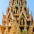 Delicate Thai art rooftop of temple  with several buddha staues — Stock Photo #64076757