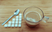 Sugar level for a cup of coffee for calories control — Stock Photo