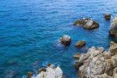 The rocky coastline. Rock in the sea — Stock Photo